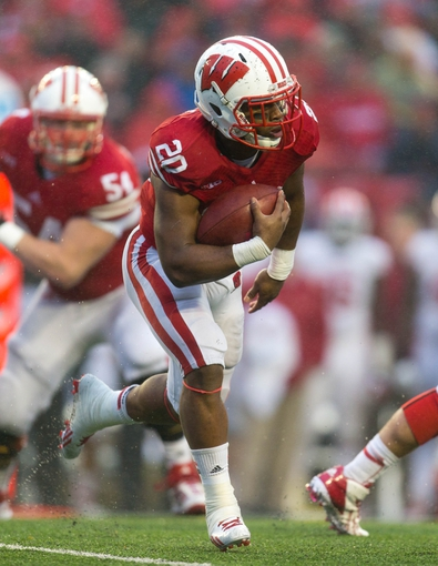 Nov 16, 2013; Madison, WI, USA; Wisconsin Badgers running back James White (20) during the game against the Indiana Hoosiers at Camp Randall Stadium. Wisconsin won 51-3.  Mandatory Credit: Jeff Hanisch-USA TODAY Sports