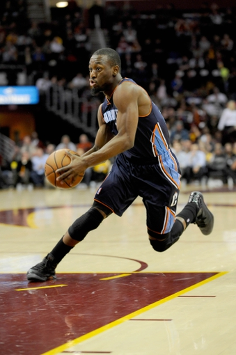 Nov 15, 2013; Cleveland, OH, USA; Charlotte Bobcats point guard Kemba Walker (15) against the Cleveland Cavaliers at Quicken Loans Arena. Mandatory Credit: Ken Blaze-USA TODAY Sports