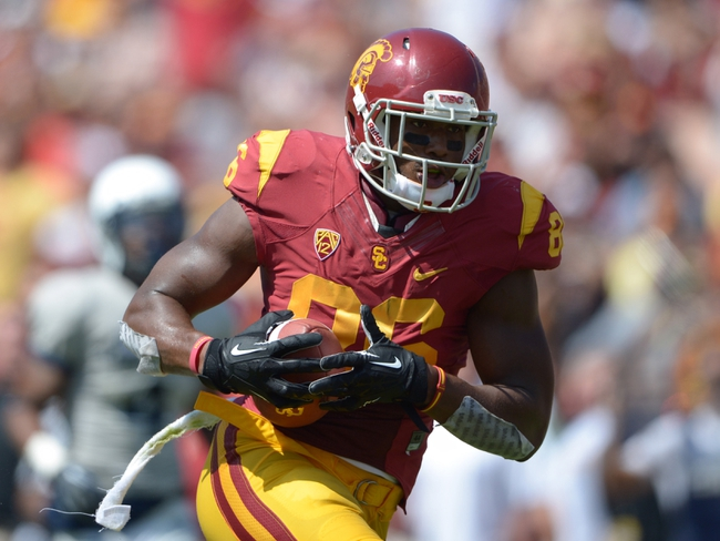 Sep 21, 2013; Los Angeles, CA, USA; Southern California Trojans tight end Xavier Grimble (86) scores on a 30-yard touchdown reception in the second quarter against the Utah State Aggies at the Los Angeles Memorial Coliseum. USC defeated Utah State 17-14. Mandatory Credit: Kirby Lee-USA TODAY Sports