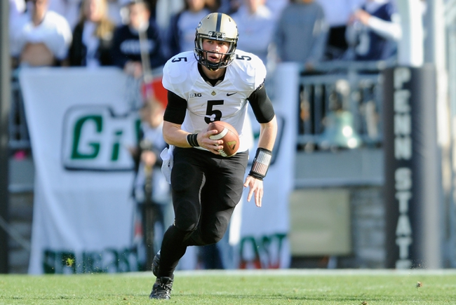Nov 16, 2013; University Park, PA, USA; Purdue Boilermakers quarterback Danny Etling (5) runs with the ball against the Penn State Nittany Lions during the third quarter at Beaver Stadium.  Penn State defeated Purdue  45-21.  Mandatory Credit: Rich Barnes-USA TODAY Sports