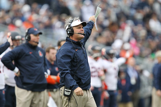 Nov 2, 2013; University Park, PA, USA; Illinois Fighting Illini head coach Tim Beckman signals from the sideline during the fourth quarter against the Penn State Nittany Lions at Beaver Stadium. Penn State defeated Illinois 24-17. Mandatory Credit: Matthew O'Haren-USA TODAY Sports