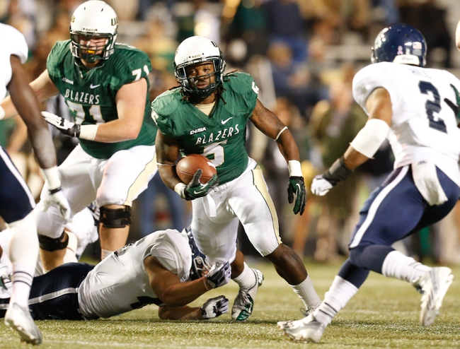 Nov 21, 2013; Birmingham, AL, USA;  UAB Blazers running back Darrin Reaves (5) is grabbed by Rice Owls linebacker Michael Kutzler (42) at Legion Field. Mandatory Credit: Marvin Gentry-USA TODAY Sports