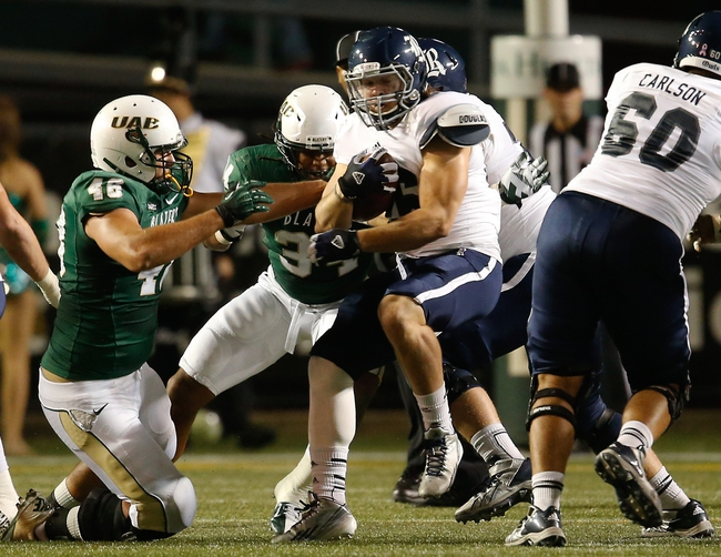 Nov 21, 2013; Birmingham, AL, USA;  Rice Owls quarterback Taylor McHargue (16) carries the ball against the UAB Blazers carries the at Legion Field. Mandatory Credit: Marvin Gentry-USA TODAY Sports