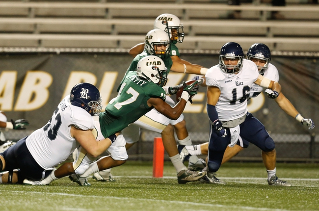 Nov 21, 2013; Birmingham, AL, USA;  UAB Blazers cornerback Jordan Petty (17) returns a fumble and is tackled by Rice Owls center Nate Richards at Legion Field. Mandatory Credit: Marvin Gentry-USA TODAY Sports