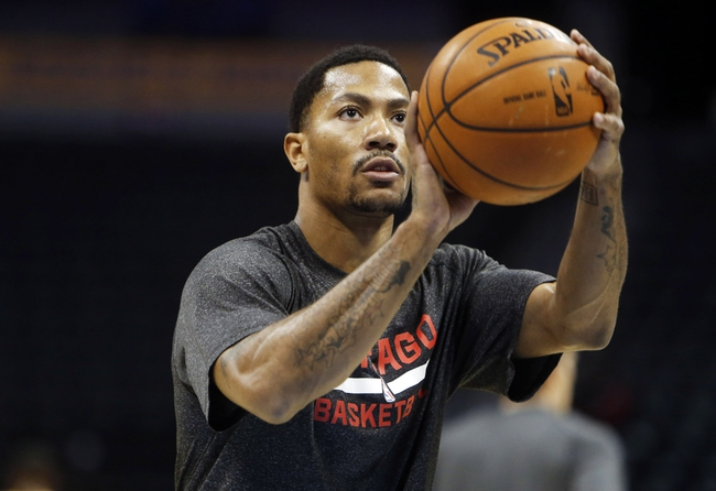 Nov 21, 2013; Denver, CO, USA; Chicago Bulls guard Derrick Rose warms up before the game against the Denver Nuggets at Pepsi Center. Mandatory Credit: Chris Humphreys-USA TODAY Sports
