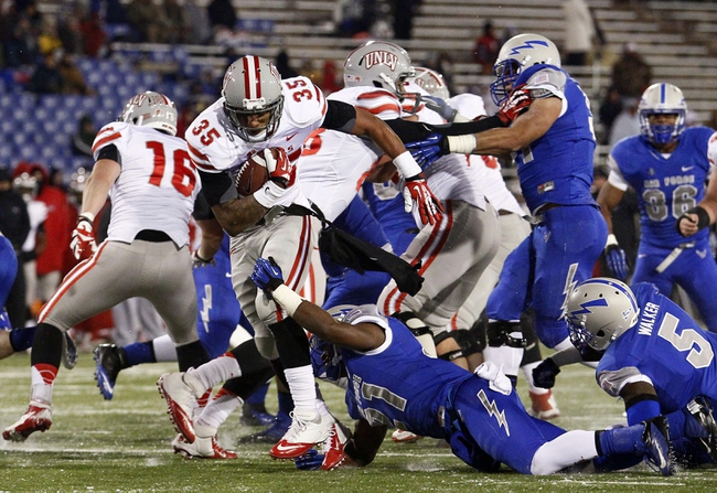 Nov 21, 2013; Colorado Springs, CO, USA; UNLV Rebels running back Tim Cornett (35) runs through the tackle of Air Force Falcons defensive back Christian Spears (21) for a touchdown in the second quarter at Falcon Stadium. Mandatory Credit: Isaiah J. Downing-USA TODAY Sports
