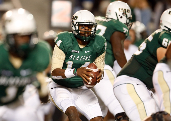 Nov 21, 2013; Birmingham, AL, USA;  UAB Blazers quarterback Jonathan Perry (14) during the game against the Rice Owls at Legion Field. The Owls defeated the Blazers 37-34 in overtime. Mandatory Credit: Marvin Gentry-USA TODAY Sports
