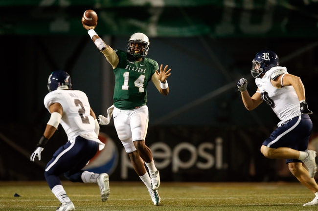 Nov 21, 2013; Birmingham, AL, USA; UAB Blazers quarterback Jonathan Perry (14) passes against the Rice Owls at Legion Field. The Owls defeated the Blazers 37-34 in overtime. Mandatory Credit: Marvin Gentry-USA TODAY Sports