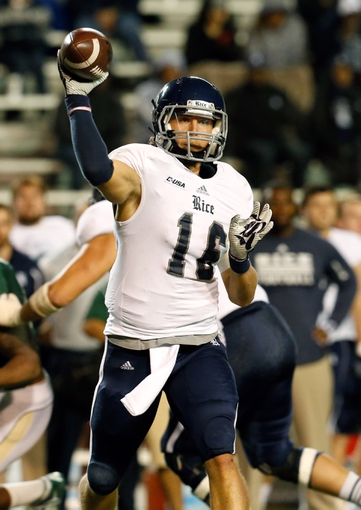 Nov 21, 2013; Birmingham, AL, USA;  Rice Owls quarterback Taylor McHargue (16) looks to pass against the UAB Blazers at Legion Field. The Owls defeated the Blazers 37-34 in overtime. Mandatory Credit: Marvin Gentry-USA TODAY Sports