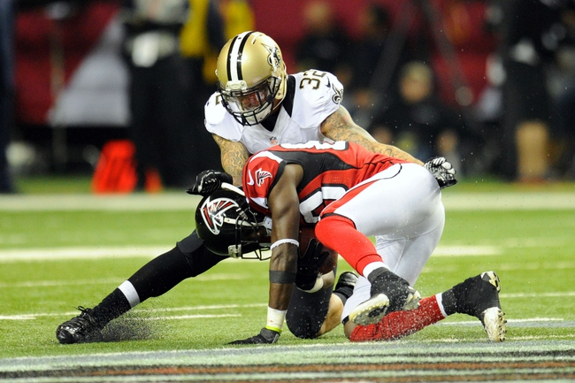Nov 21, 2013; Atlanta, GA, USA; Atlanta Falcons wide receiver Harry Douglas (83) is tackled by New Orleans Saints safety Kenny Vaccaro (32) during the second half at the Georgia Dome. The Saints defeated the Falcons 17-13. Mandatory Credit: Dale Zanine-USA TODAY Sports