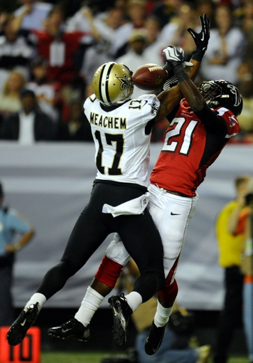 Nov 21, 2013; Atlanta, GA, USA; Atlanta Falcons cornerback Desmond Trufant (21) breaks up a pass intended for New Orleans Saints wide receiver Robert Meachem (17) during the second half at the Georgia Dome. The Saints defeated the Falcons 17-13. Mandatory Credit: Dale Zanine-USA TODAY Sports