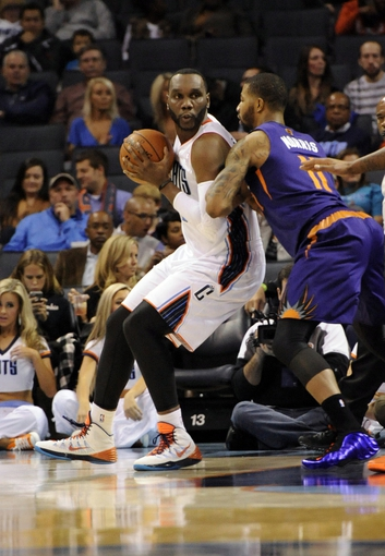 Nov 22, 2013; Charlotte, NC, USA; Charlotte Bobcats center Al Jefferson (25) looks to pass as he is defended by Phoenix Suns forward Markieff Morris (11) during the first half of the game at Time Warner Cable Arena. Mandatory Credit: Sam Sharpe-USA TODAY Sports