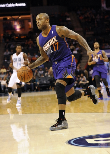 Nov 22, 2013; Charlotte, NC, USA; Phoenix Suns forward guard P.J. Tucker (17) drives down the court during the first half of the game against the Charlotte Bobcats at Time Warner Cable Arena. Mandatory Credit: Sam Sharpe-USA TODAY Sports