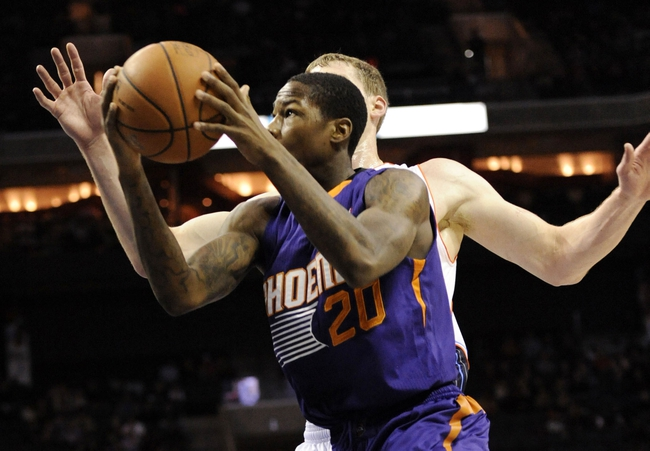Nov 22, 2013; Charlotte, NC, USA; Phoenix Suns guard Archie Goodwin (20) drives past Charlotte Bobcats forward Cody Zeller (40) during the first half of the game at Time Warner Cable Arena. Mandatory Credit: Sam Sharpe-USA TODAY Sports