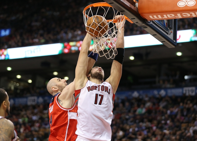 Nov 22, 2013; Toronto, Ontario, CAN; Toronto Raptors center Jonas Valanciunas (17) dunks against the Washington Wizards center Marcin Gortat (4) at Air Canada Centre. The Raptors beat the Wizards 96-88. Mandatory Credit: Tom Szczerbowski-USA TODAY Sports