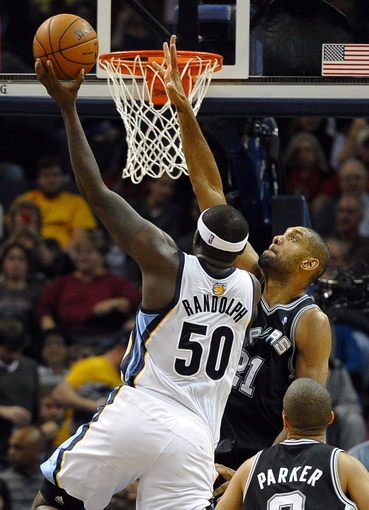 Nov 22, 2013; Memphis, TN, USA; Memphis Grizzlies power forward Zach Randolph (50) lays the ball up over San Antonio Spurs power forward Tim Duncan (21) during the second quarter at FedExForum. Mandatory Credit: Justin Ford-USA TODAY Sports