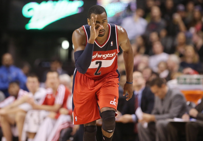 Nov 22, 2013; Toronto, Ontario, CAN; Washington Wizards point guard John Wall (2) celebrates after hitting a three-point shot against the Toronto Raptors at Air Canada Centre. The Raptors beat the Wizards 96-88. Mandatory Credit: Tom Szczerbowski-USA TODAY Sports