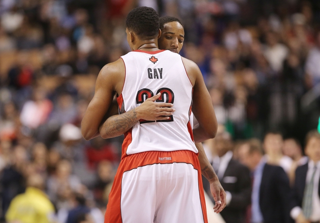 Nov 22, 2013; Toronto, Ontario, CAN; Toronto Raptors forward Rudy Gay (22) celebrates with guard DeMar DeRozan (10) after defeating the Washington Wizards at Air Canada Centre. The Raptors beat the Wizards 96-88. Mandatory Credit: Tom Szczerbowski-USA TODAY Sports