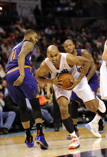Nov 22, 2013; Charlotte, NC, USA; Charlotte Bobcats guard Gerald Henderson (9) drives past Phoenix Suns forward Markieff Morris (11) during the second half of the game at Time Warner Cable Arena.Suns win 98-91.  Mandatory Credit: Sam Sharpe-USA TODAY Sports