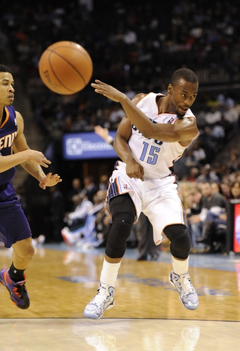 Nov 22, 2013; Charlotte, NC, USA; Charlotte Bobcats guard Kemba Walker (15) passes the ball during the second half of the game against the Phoenix Suns at Time Warner Cable Arena. Suns win 98-91. Mandatory Credit: Sam Sharpe-USA TODAY Sports