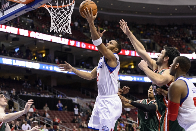Nov 22, 2013; Philadelphia, PA, USA; Philadelphia 76ers guard Evan Turner (12) shoots during overtime against the Milwaukee Bucks at Wells Fargo Center. The Sixers defeated the Bucks 115-107 in overtime. Mandatory Credit: Howard Smith-USA TODAY Sports