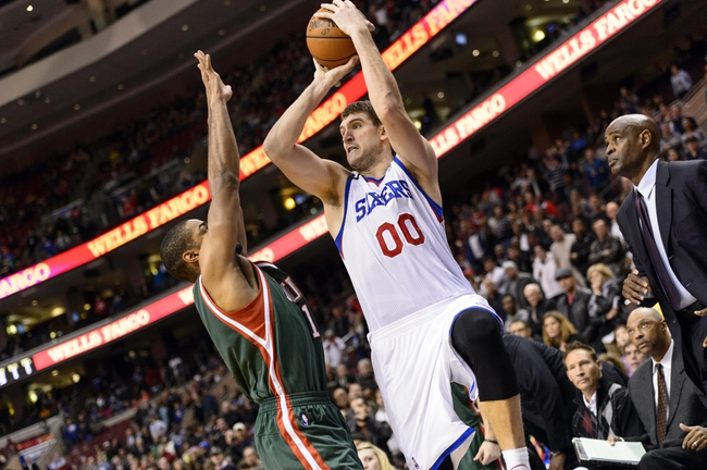 Nov 22, 2013; Philadelphia, PA, USA; Philadelphia 76ers center Spencer Hawes (00) hits a jumps shot to tie the game late in the fourth quarter against the Milwaukee Bucks at Wells Fargo Center. The Sixers defeated the Bucks 115-107 in overtime. Mandatory Credit: Howard Smith-USA TODAY Sports