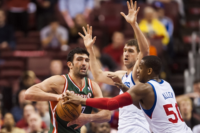 Nov 22, 2013; Philadelphia, PA, USA; Philadelphia 76ers center Lavoy Allen (50) strips Milwaukee Bucks center Zaza Pachulia (27) of the ball during overtime at Wells Fargo Center. The Sixers defeated the Bucks 115-107 in overtime. Mandatory Credit: Howard Smith-USA TODAY Sports