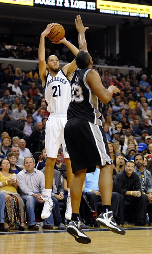 Nov 22, 2013; Memphis, TN, USA; Memphis Grizzlies small forward Tayshaun Prince (21) shoots the ball over San Antonio Spurs power forward Boris Diaw (33) during the third quarter at FedExForum. Mandatory Credit: Justin Ford-USA TODAY Sports