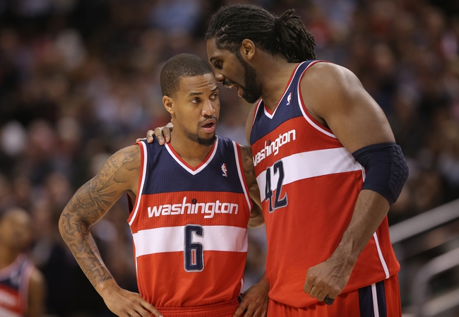 Nov 22, 2013; Toronto, Ontario, CAN; Washington Wizards forward Nene (42) talks to guard Eric Maynor (6) during a break in the action against the Toronto Raptors at Air Canada Centre. The Raptors beat the Wizards 96-88. Mandatory Credit: Tom Szczerbowski-USA TODAY Sports