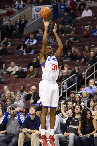 Nov 22, 2013; Philadelphia, PA, USA; Philadelphia 76ers forward Hollis Thompson (31) shoots a jump shot during overtime against the Milwaukee Bucks at Wells Fargo Center. The Sixers defeated the Bucks 115-107 in overtime. Mandatory Credit: Howard Smith-USA TODAY Sports