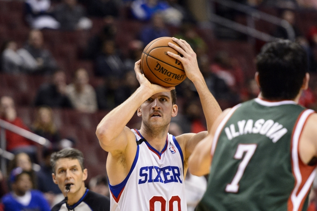 Nov 22, 2013; Philadelphia, PA, USA; Philadelphia 76ers center Spencer Hawes (00) shoots a jump shot during the fourth quarter against the Milwaukee Bucks at Wells Fargo Center. The Sixers defeated the Bucks 115-107 in overtime. Mandatory Credit: Howard Smith-USA TODAY Sports