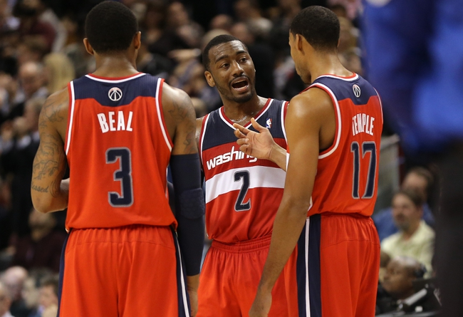Nov 22, 2013; Toronto, Ontario, CAN; Washington Wizards guard John Wall (2) talks to  guard Garrett Temple (17) and guard Bradley Beal (3) against the Toronto Raptors at Air Canada Centre. The Raptors beat the Wizards 96-88. Mandatory Credit: Tom Szczerbowski-USA TODAY Sports