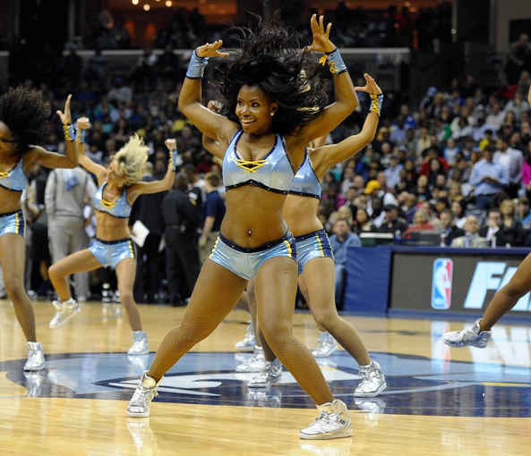 Nov 22, 2013; Memphis, TN, USA; Memphis Grizzlies dancers perform during a timeout against the San Antonio Spurs during the fourth quarter at FedExForum. San Antonio Spurs beat the Memphis Grizzlies 102-86. Mandatory Credit: Justin Ford-USA TODAY Sports