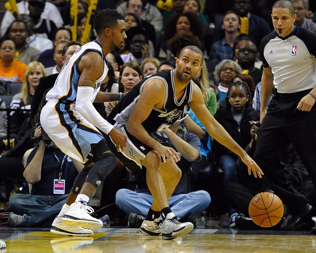Nov 22, 2013; Memphis, TN, USA; San Antonio Spurs point guard Tony Parker (9) is guarded by Memphis Grizzlies point guard Mike Conley (11) during the fourth quarter at FedExForum. San Antonio Spurs beat the Memphis Grizzlies 102-86. Mandatory Credit: Justin Ford-USA TODAY Sports