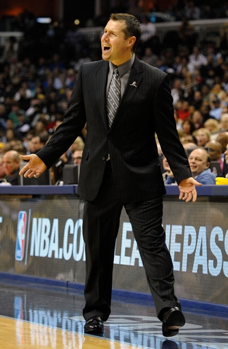 Nov 22, 2013; Memphis, TN, USA; Memphis Grizzlies head coach David Joerger reacts during the game against the San Antonio Spurs during the fourth quarter at FedExForum. San Antonio Spurs beat the Memphis Grizzlies 102-86. Mandatory Credit: Justin Ford-USA TODAY Sports