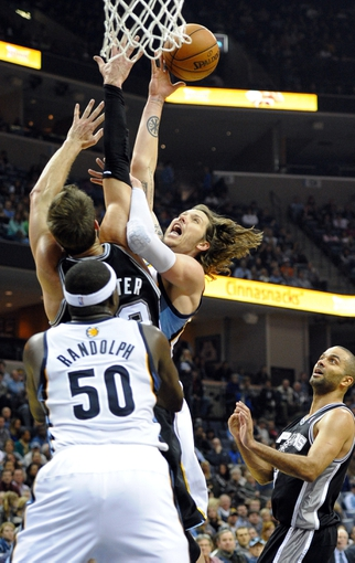 Nov 22, 2013; Memphis, TN, USA; Memphis Grizzlies small forward Mike Miller (13) lays the ball up against San Antonio Spurs center Tiago Splitter (22) during the fourth quarter at FedExForum. San Antonio Spurs beat the Memphis Grizzlies 102-86. Mandatory Credit: Justin Ford-USA TODAY Sports