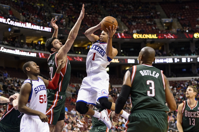 Nov 22, 2013; Philadelphia, PA, USA; Philadelphia 76ers guard Michael Carter-Williams (1) shoots under pressure from Milwaukee Bucks center Zaza Pachulia (27) during the fourth quarter at Wells Fargo Center. The Sixers defeated the Bucks 115-107 in overtime. Mandatory Credit: Howard Smith-USA TODAY Sports
