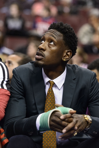 Nov 22, 2013; Philadelphia, PA, USA Milwaukee Bucks center Larry Sanders (8) watches from the bench during the fourth quarter against the Philadelphia 76ers at Wells Fargo Center. The Sixers defeated the Bucks 115-107 in overtime. Mandatory Credit: Howard Smith-USA TODAY Sports