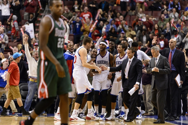 Nov 22, 2013; Philadelphia, PA, USA; Philadelphia 76ers center Spencer Hawes (00) celebrates with teammates after tying the game during the fourth quarter against the Milwaukee Bucks at Wells Fargo Center. The Sixers defeated the Bucks 115-107 in overtime. Mandatory Credit: Howard Smith-USA TODAY Sports