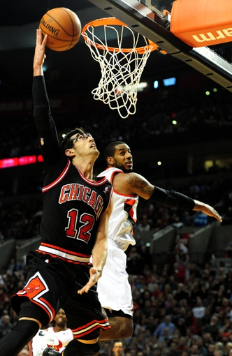 Nov 22, 2013; Portland, OR, USA; Chicago Bulls shooting guard Kirk Hinrich (12) drives to the basket on Portland Trail Blazers power forward LaMarcus Aldridge (12) during the fourth quarter of the game at the Moda Center. The Blazers won the game 98-95. Mandatory Credit: Steve Dykes-USA TODAY Sports