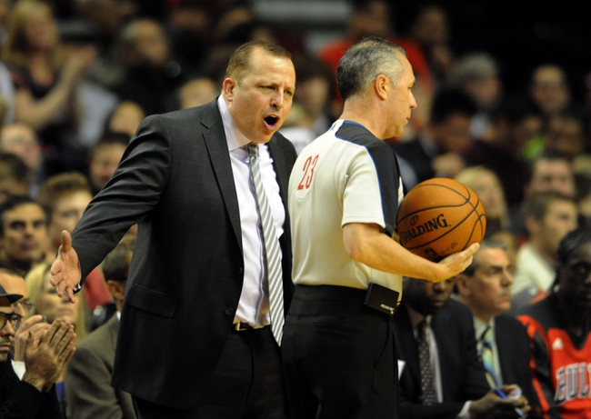 Nov 22, 2013; Portland, OR, USA; Chicago Bulls head coach Tom Thibodeau speaks with referee Jason Phillips (23) during the third quarter of the game against the Portland Trail Blazers at the Moda Center. The Blazers won the game 98-95. Mandatory Credit: Steve Dykes-USA TODAY Sports