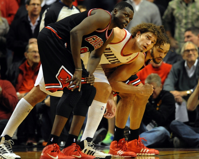 Nov 22, 2013; Portland, OR, USA; Chicago Bulls small forward Luol Deng (9), Portland Trail Blazers center Robin Lopez (42) and Bulls center Joakim Noah (13) battle for position for a rebound during the fourth quarter of the game at the Moda Center. The Blazers won the game 98-95. Mandatory Credit: Steve Dykes-USA TODAY Sports