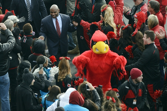 Nov 23, 2013; Louisville, KY, USA; Louisville Cardinals head coach Charlie Strong greets fans during the Card March before the start of game against the Memphis Tigers at Papa Johns Cardinal Stadium. Mandatory Credit: Jamie Rhodes-USA TODAY Sports
