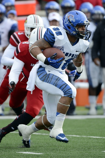 Nov 23, 2013; Louisville, KY, USA; Memphis Tigers running back Brandon Hayes (38) runs the ball against the Louisville Cardinals during the first quarter at Papa Johns Cardinal Stadium. Mandatory Credit: Jamie Rhodes-USA TODAY Sports