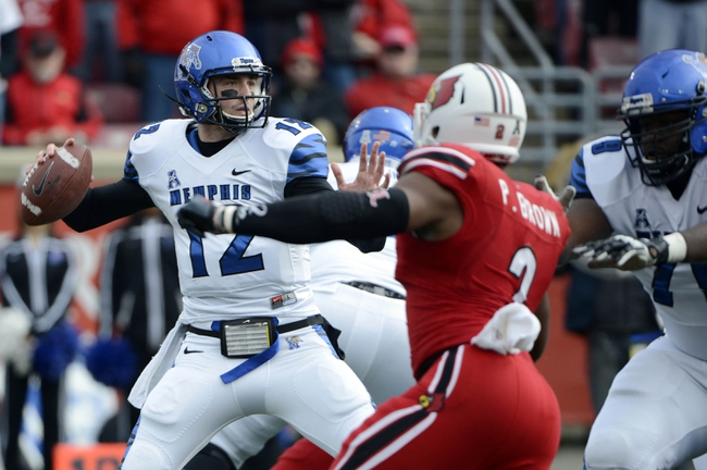 Nov 23, 2013; Louisville, KY, USA; Memphis Tigers quarterback Paxton Lynch (12) looks to pass against the Louisville Cardinals during the first quarter at Papa Johns Cardinal Stadium. Mandatory Credit: Jamie Rhodes-USA TODAY Sports