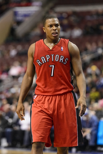 Nov 20, 2013; Philadelphia, PA, USA; Toronto Raptors guard Kyle Lowry (7) during the fourth quarter against the Philadelphia 76ers at Wells Fargo Center. The Raptors defeated the Sixers 108-98. Mandatory Credit: Howard Smith-USA TODAY Sports