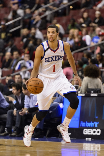 Nov 20, 2013; Philadelphia, PA, USA; Philadelphia 76ers guard Michael Carter-Williams (1) brings the ball up court during the fourth quarter against the Toronto Raptors at Wells Fargo Center. The Raptors defeated the Sixers 108-98. Mandatory Credit: Howard Smith-USA TODAY Sports