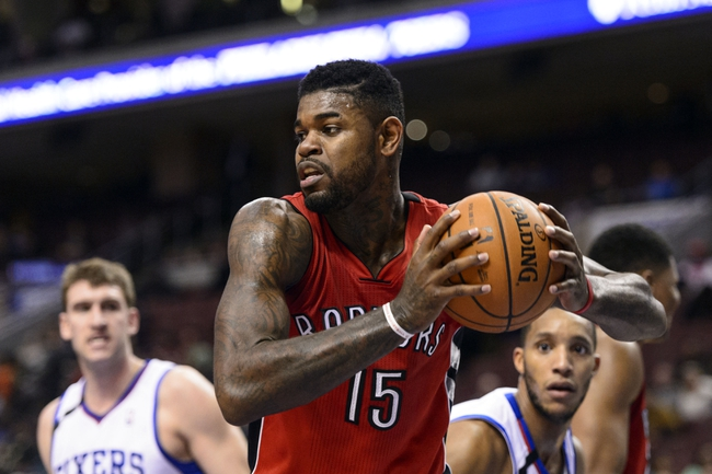 Nov 20, 2013; Philadelphia, PA, USA; Toronto Raptors forward Amir Johnson (15) during the fourth quarter against the Philadelphia 76ers at Wells Fargo Center. The Raptors defeated the Sixers 108-98. Mandatory Credit: Howard Smith-USA TODAY Sports
