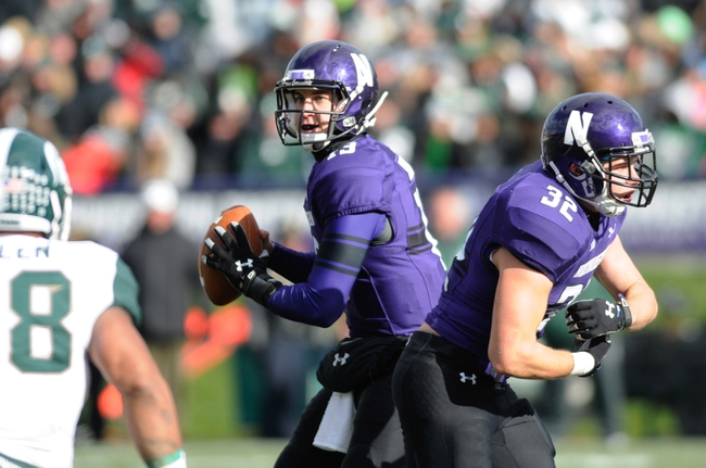 Nov 23, 2013; Evanston, IL, USA; Northwestern Wildcats quarterback Trevor Siemian (13) drops back to pass during the second quarter against the Michigan State Spartans at Ryan Field. Mandatory Credit: Reid Compton-USA TODAY Sports