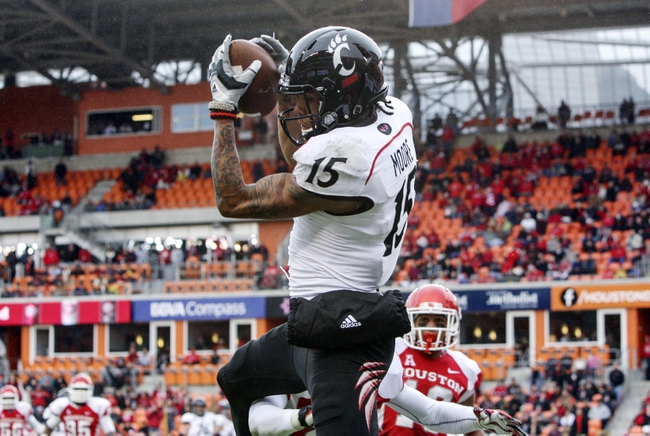Nov 23, 2013; Houston, TX, USA; Cincinnati Bearcats wide receiver Chris Moore (15) catches a pass for a touchdown during the second quarter against the Houston Cougars at BBVA Compass Stadium. Mandatory Credit: Troy Taormina-USA TODAY Sports